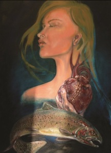woman holding heart above fish